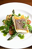 Halibut fillet with asparagus, tomatoes and peas