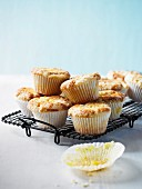 Lemon crumble cupcakes on a cooling rack