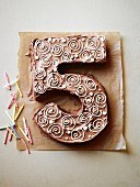A cake in the shape of a number 5, for a birthday