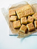Cake, cut into cubes, on grease-proof paper