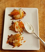 Mini potato fritters with smoked salmon and trout caviar