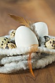 Eggs and feathers in an Easter nest