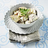 A Bowl of Cape Cod Potato Salad with Red Potatoes, Dill, Onion and Celery