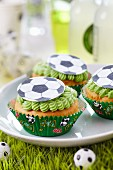Fairy cakes with football decorations