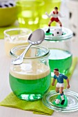 Woodruff jelly with vanilla sauce and football decorations