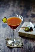 A Bloody Mary Martini with pickled gherkin
