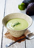 Cold avocado soup with a sprig of dill