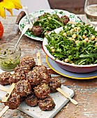 Dukkah meatballs with chickpea and rocket salad and chimichurri sauce