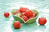 Fresh strawberries in a leaf-shaped bowl