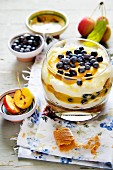 A layered dessert of quark, fruit purée and blueberries