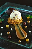 A quenelle of quark with rum-soaked raisins on crumble