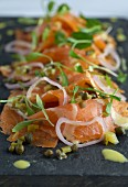 Gravad lax with a citrus marinade, onions and capers