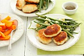 Breaded chicken fillets with green beans