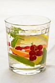 A fruity drink with fresh apricots, redcurrants, lime and lemon balm