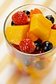 Fruit salad with mango, strawberries, blackcurrants and apricots