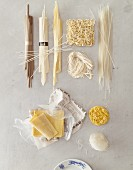 A still life featuring assorted types of Asian noodle (view from above)