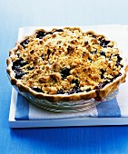 Blueberry crumble pie in a glass baking dish