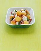 Melon salad with mozzarella balls and Prosciutto