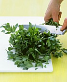 Parsley being finely sliced