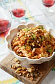 Pasta with cheese, pine nuts and fennel