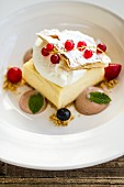 Mille feuille with berries, cream and rhubarb foam
