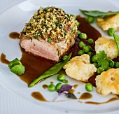 Crispy pork with dumplings and peas