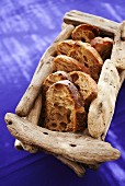 Slices of rustic bread in a wooden basket