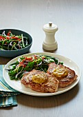 Pork steaks with chilli butter and a sugar snap pea salad (Asia)