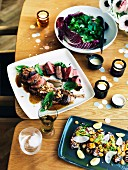 Barbecued lamb and calamari with salad leaves