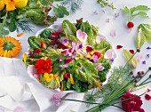 A colourful plate of salad with edible flowers