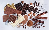 Assorted types of chocolate, filled chocolates and cocoa powder