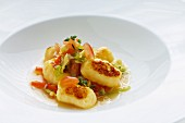 Potato gnocchi with tomatoes and savoy cabbage