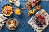 Assorted Breakfast Setting; Cold Cereal, Fruit, Toast and Orange Juice