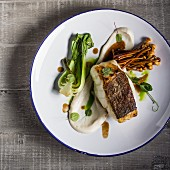 Cod with cauliflower puree, pak choi end enoki mushrooms