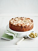 Macadamia nut cake with crumble topping and gooseberries