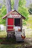 Homemade, rustic chicken coop with names