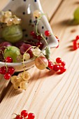 Redcurrants and whitecurrants, red and green gooseberries, and a ladle