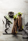 Fresh black salsify and peppercorns on the vine