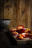 Preparing Red Plums on a Wooden Cutting Board