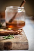 Wooden spoon with honey and a sprig of rosemary