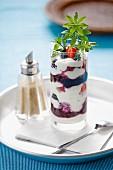 Quark and yoghurt dessert with berries and woodruff