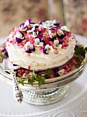 A celebratory cake decorated with horned violets