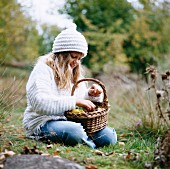 Girl with a basket in the countryside, Sweden.