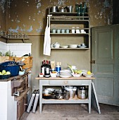 Simple kitchen with peeling paint on walls