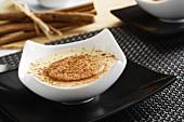 Custard with cinnamon and crackers