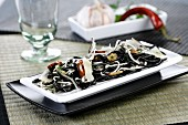 Squid ink spaghetti with parmesan and garlic