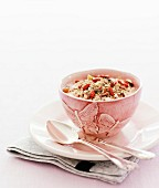 Cereal in pink bowl with butterfly carving