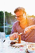 Man having meal outdoor