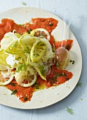 Vegetable salad with lemons and wild salmon
