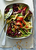 Pasta salad with peppers, sardines, pine nuts and parmesan dressing